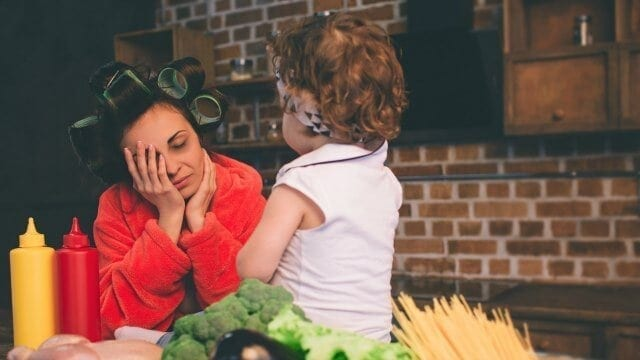 Woman overwhelmed by motherhood