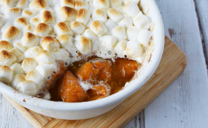 These Traditional Easy Candied Yams are the perfect side dish for your Thanksgiving dinner, or a delicious and sweet side dish you can serve anytime you have a big family gather or party.  But, this Thanksgiving sweet potato dish is perfect. #thanksgivingrecipe #thanksgivingrecipes #recipes #recipe #yams #candiedyams #sweetpotatoes