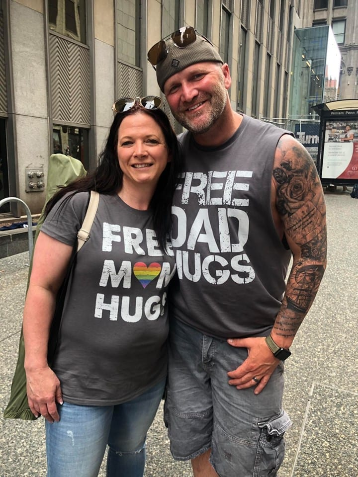 "Dad Offers ""Free Dad Hugs"" At Pride Parade As Strangers Sob In His Arms. He Urges Parents To Love Their Children In Viral Post."